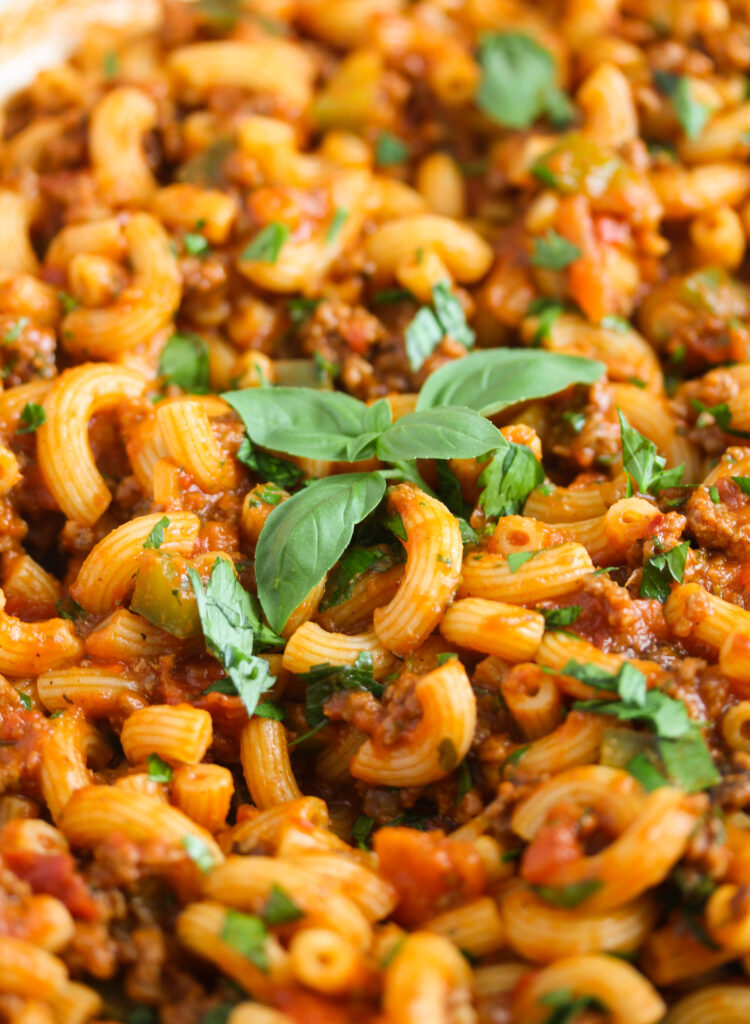 american goulash with basil on top.