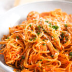 spaghetti with tomato sauce piled in a bowl.