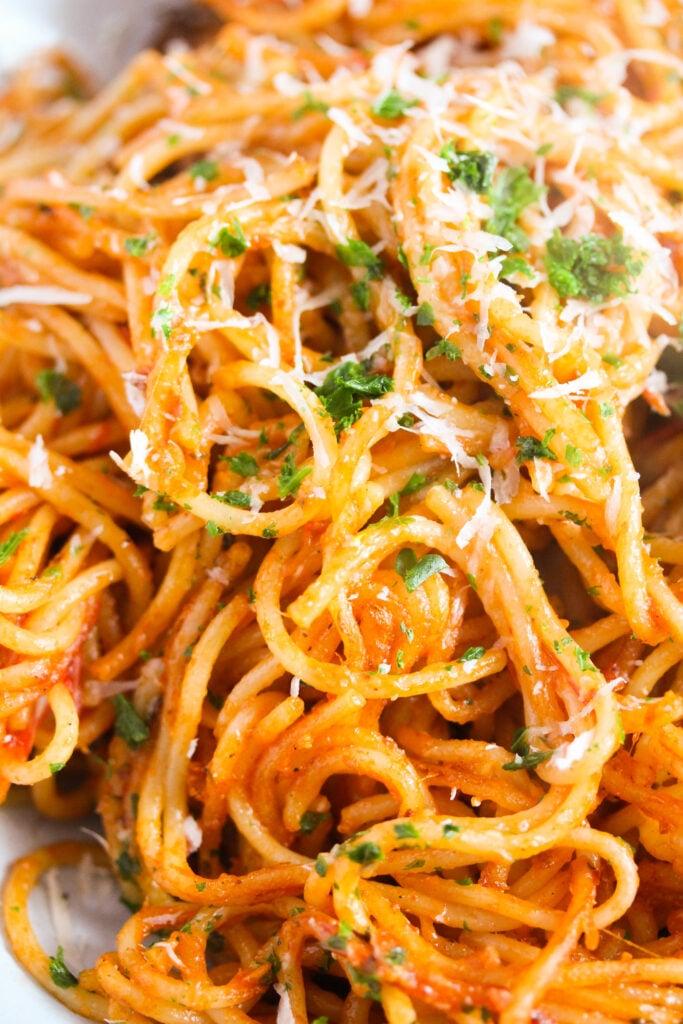 close up tangled spaghetti with sauce.
