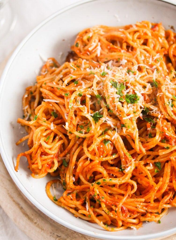 bowl of tomato pasta close up.