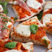 many slices of flatbread pizza margherita-style.