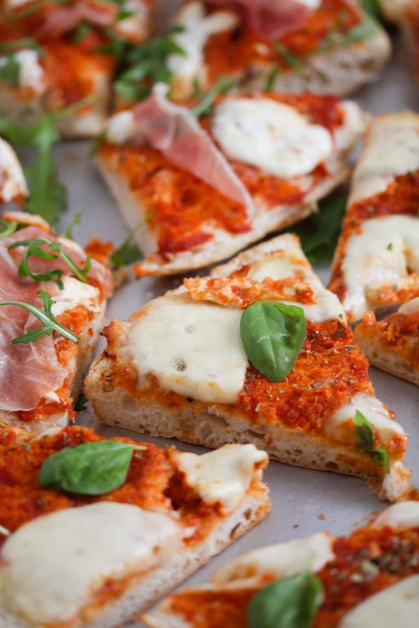 many slices of flatbread margherita pizza