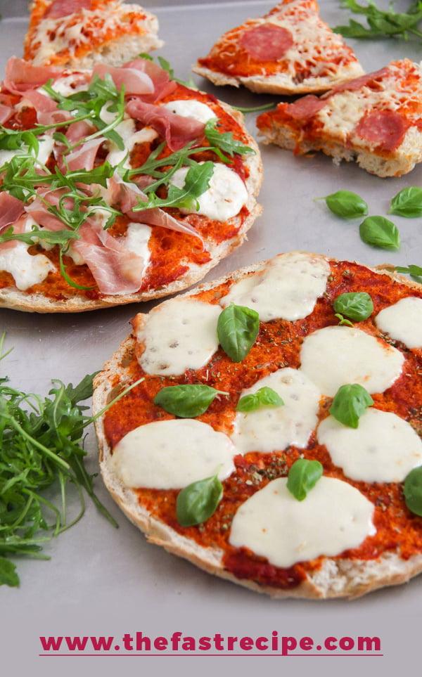 margherita flatbread pizza made on flatbread or pita with mozzarella and basil.