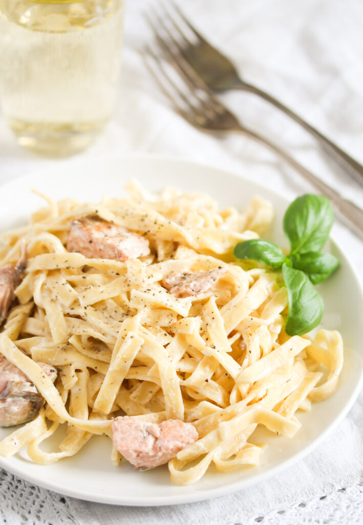 plate full of pasta with cream sauce.