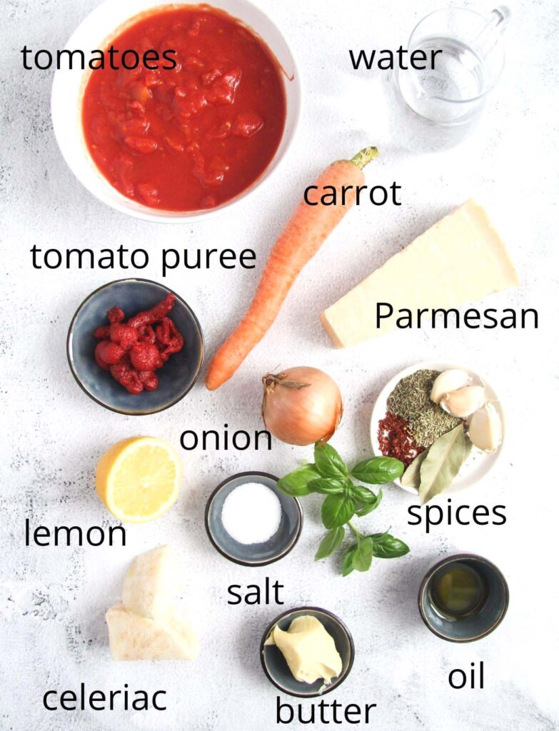ingredients for making marinara arranged on the table.