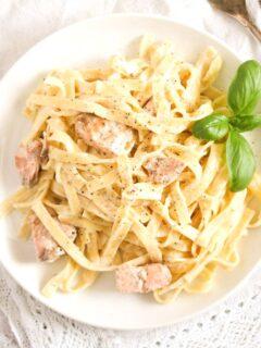 heaped creme fraiche salmon pasta on a small plate.