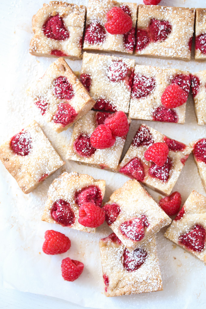 blondies with white chocolate and topped with fresh berries.