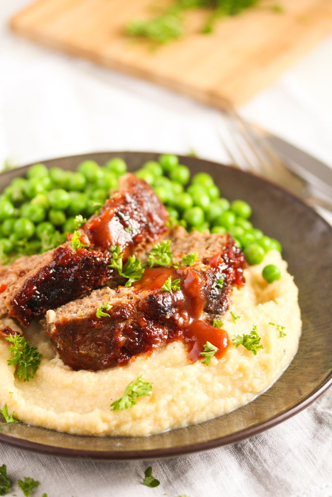 air fried meatloaf slices with peas and cauliflower mash.