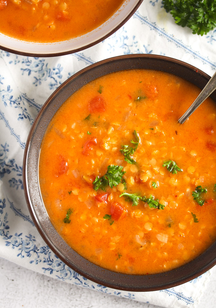 brown bowl with lebanese soup with red lentils.